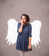 Young girl with angel illustrated wings