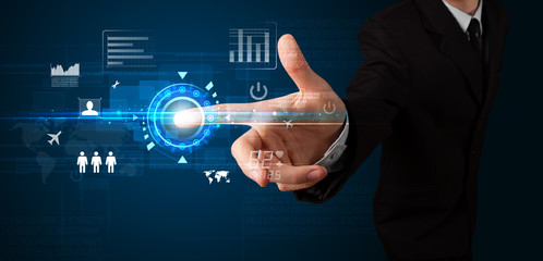 Handsome businessman touching future web technology buttons and