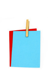 writingpaper held together with a clothespin with room for text