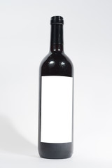 wine bottle with empty label on isolated background