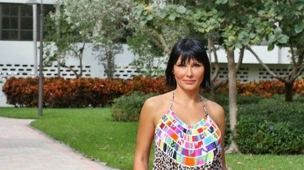 Woman posing for the camera in an outdoor garden setting