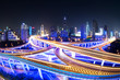 illuminated traffic on elevated expressway in modern city. - 79445714