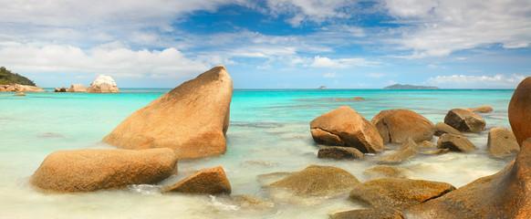 Seychelles lagoon beach with  stones