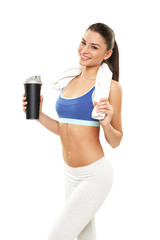 Young woman with protein shake bottle on white background