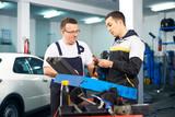 Mechanics in car service poster