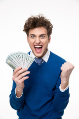 Happy businessman holding money over gray background