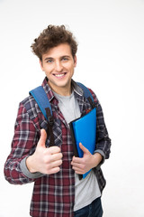 Happy male student with backpack and folders showing thumb up