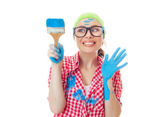 Lovely girl holding paint brush,