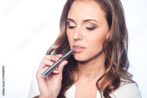 Young woman portrait with e-cigarette - 79448995