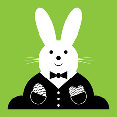vector Easter bunny with suit and eggs
