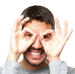 Happy guy with observe gesture