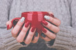 Leinwanddruck Bild - Woman with manicured nails holding a cup