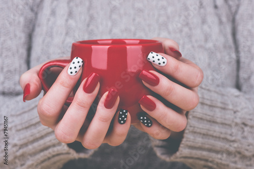 Foto op Canvas Manicure Woman with manicured nails holding a cup
