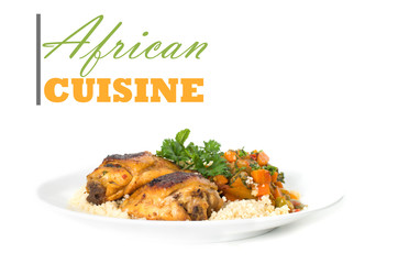 African cuisine concept with chicken thigh on couscous rice with