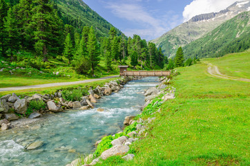 Mountain stream and the high peaks of the Austrian Alps