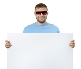 Bearded man in sun glasses holding white billboard