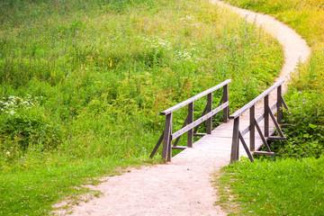 Old wooden bridge and walking lane