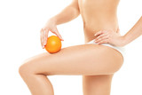 Young woman in underwear holding an orange showing absence of ce - 79453162