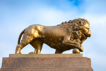 Bronze lion with ball, monument on stone base