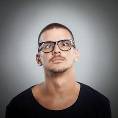 Close-up of cross-eyed young man posing