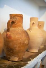 Close-up view of old ceramic jars.