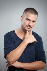 Portrait of handsome young man looking at camera. Studio shot.