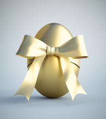 Goldenes Osterei  mit Schleife