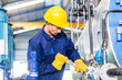 Technician in factory at machine maintenance - 79454318