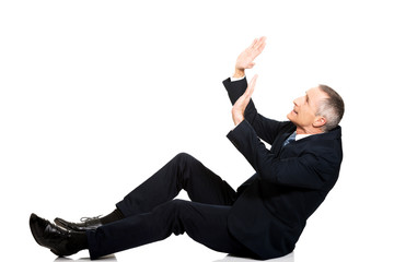 Businessman protecting himself from empty space