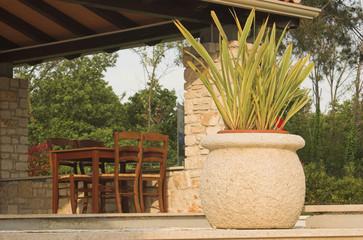 Big teracotta pot on a restaurant terrace
