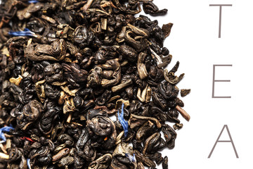 Dried Black Tea leaves isolated on a white background close up w