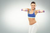 Fototapety Beautiful young woman exercise with dumbbells on white backgroun