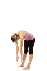 Young woman in bent yoga pose.