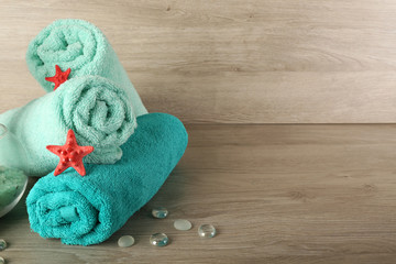 Beautiful towels with sea stars and decorative stones