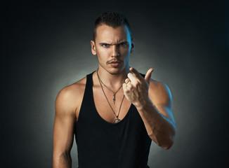 man points a finger on  black background