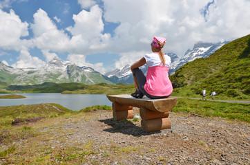 Traveler at a mountain lake. Switzerland