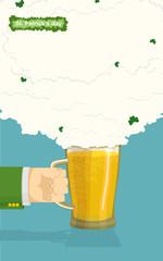 St. Patrick's Day Mug of beer. hand holding a mug beer