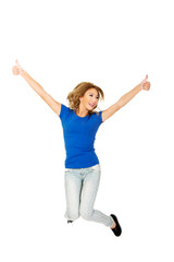 Young happy woman jumping with thumbs up.