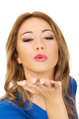 Young woman blowing a kiss.