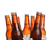 Glass bottles of beer in ice cubes isolated on white - 79459926