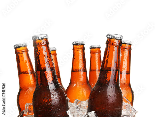 Fotobehang Cocktail Glass bottles of beer in ice cubes isolated on white