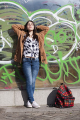 Young latina girl in the street sunbathing