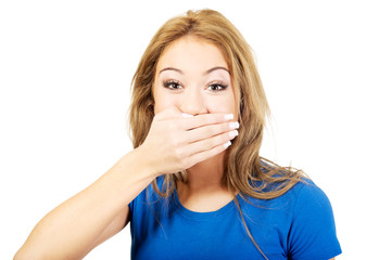 Woman covering her mouth.