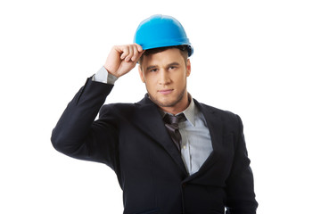 Happy businessman with blue hard hat.