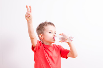Young boy with a bottle of mineral water