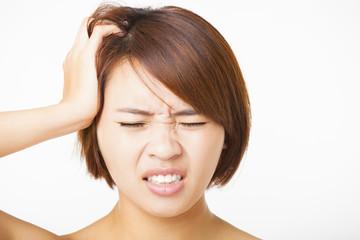Closeup   young woman  with headache