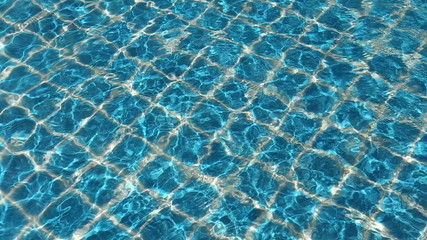 Beautiful sunny blue swimming pool water.