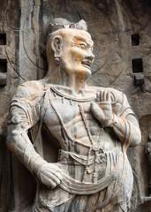 Stone buddhist statue in Longmen Grottoes