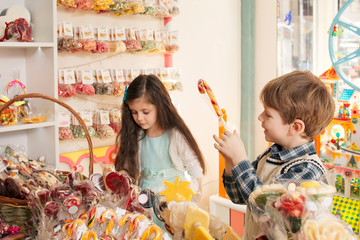 Happy children in a candy store