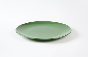Round solid green dinner plate